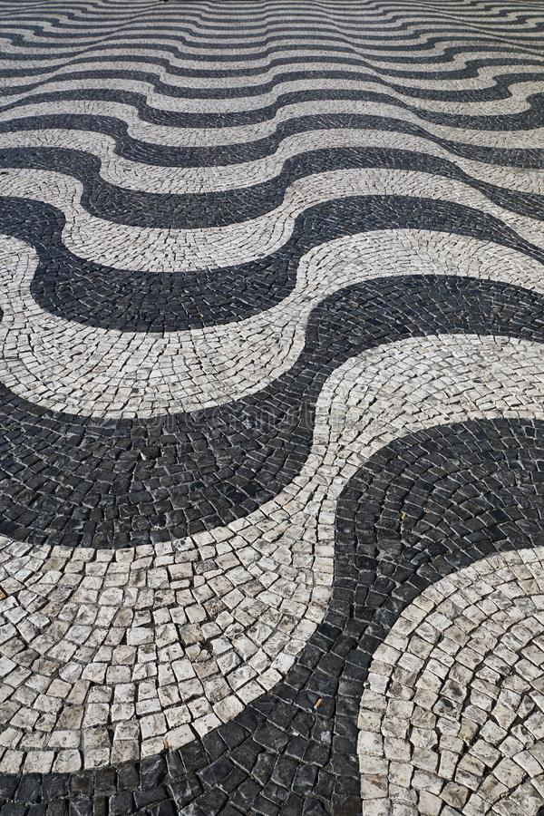 Lisbon, Portugal:  Wavy paving stones pattern in Lisbon /Portugal. September 15th 2017, Lisbon, Portugal:  Wavy paving stones pattern in Lisbon /Portugal, Rossio stock image
