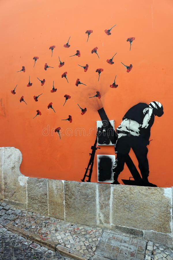Lissabon Portugal: Cloves fired from mortar, mural, Banksy, Cloves Revolution 1974, Lisbon Portugal royalty free stock photos