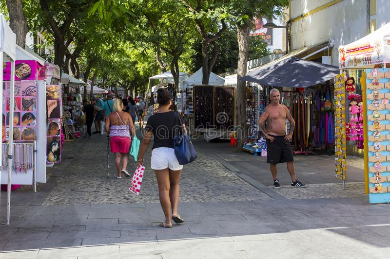 Tourists stroll the cobbled streets of the Old Town in Albuferia. 28 September 2018 Tourists stroll the cobbled streets of the Old Town in Albuferia on the royalty free stock images