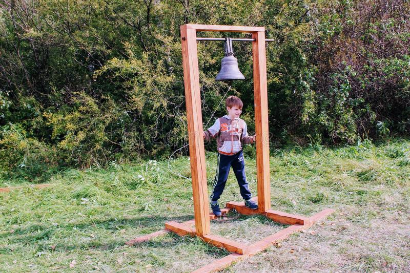 September, 16 2017, Tula, Russia - The International Military and Historical Festival `Kulikovo Field`: the boy is ringing bell stock image