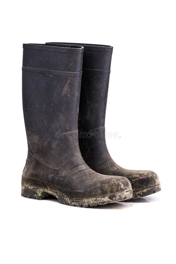Seque as botas sujas da lama isoladas na opinião do branco 3/4 fotografia de stock