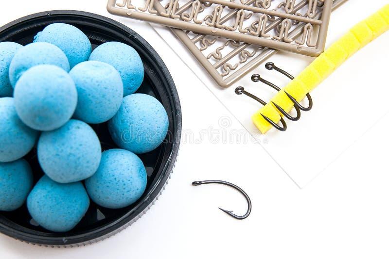 Seque la alimentación para la pesca de la carpa Boilies y accesorios de la carpa para la carpa imágenes de archivo libres de regalías