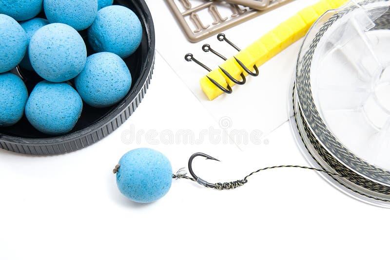 Seque la alimentación para la pesca de la carpa Boilies y accesorios de la carpa para la carpa imagen de archivo libre de regalías