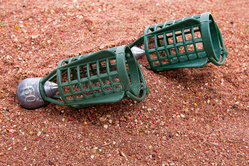 Seque la alimentación para la pesca de la carpa como fondo Diverso feede de la pesca fotografía de archivo
