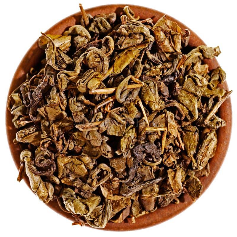 Download Seque O Chá Verde Em Um Copo Da Argila De Acima Foto de Stock - Imagem de seco, chinês: 26517088