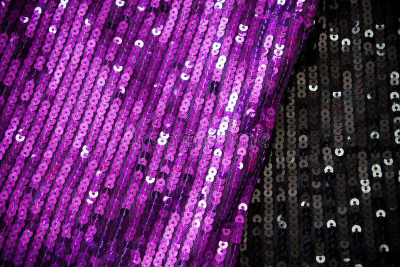 Sequin fabrics. Background from violet and black sequin fabrics royalty free stock photo
