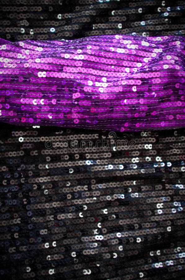 Sequin fabrics. Background from violet and black sequin fabrics royalty free stock image