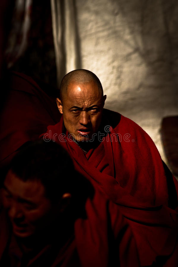 Sera Monastery Debating Monk ponders in Lhasa Tibet. Sera Monastery Debating Monk ponders in the city of Lhasa, Tibet royalty free stock photo