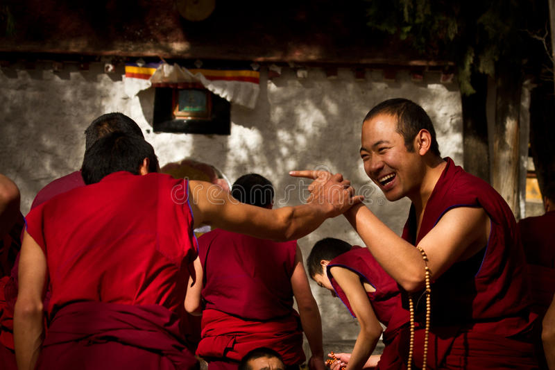 Sera Monastery Debating Monks laugh in Lhasa Tibet. Sera Monastery Debating Monks laughing in Lhasa, Tibet stock photo