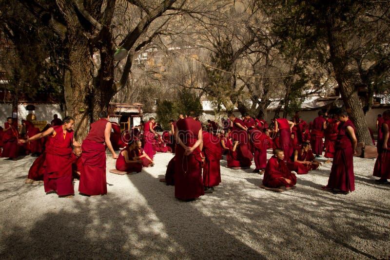 Sera Monastery group of Debating Monks Lhasa Tibet. Sera Monastery Debating Monks stand in a group, Lhasa, Tibet royalty free stock images