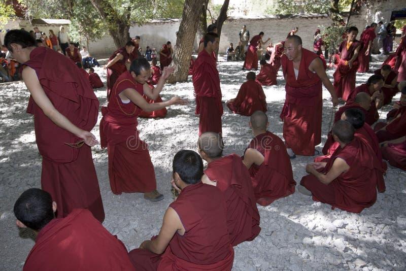 Sera Monastery - Tibet. Monks debating in the grounds of Sera Monastery near Lhasa in the Tibet Autonomous Region of China stock photos