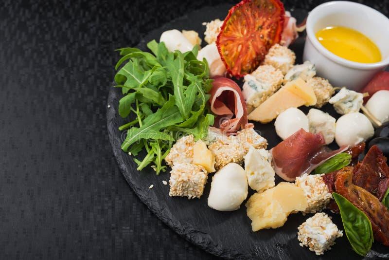 sera ustalony jedzenie z prosciutto mięsem obrazy royalty free