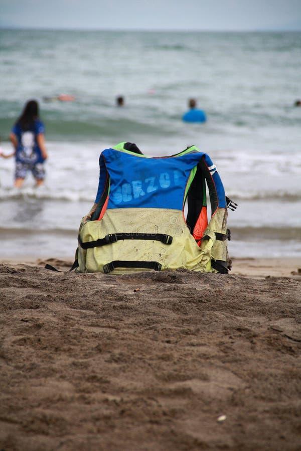 Life vest on beach. Serang, Indonesia - November 12, 2017: Life vest on Anyer Beach, Serang, Banten. Used to swim stock photography