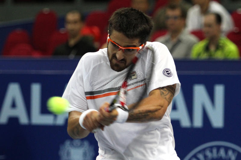 Serbia's Janko Tipsarevic return the ball stock images