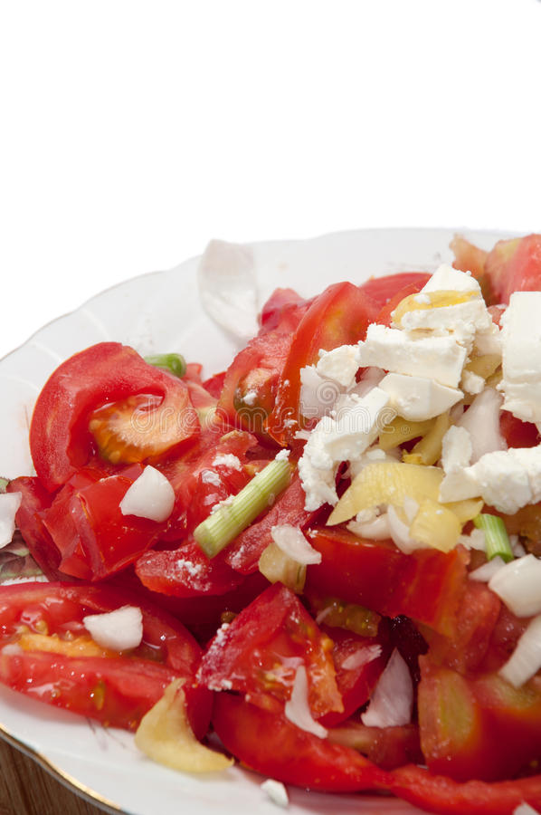 Serbian balkan sopska salad with tomato onion and cheese stock images