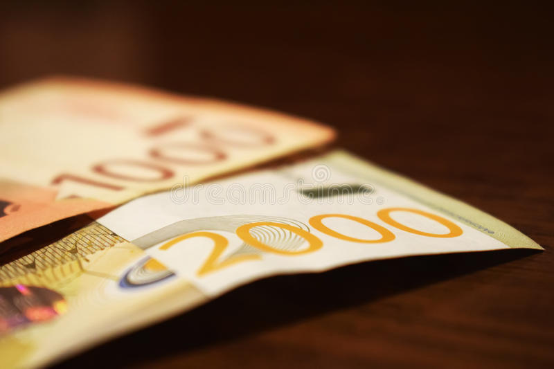 Serbian money in paper, banknote 1000 and 2000 dinars value royalty free stock photography