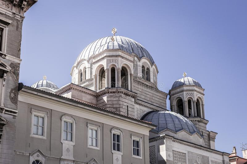 Serbian orthodox Saint spyridon church Chiesa di San Spiridione in Trieste, Italy near the canal grande on the square saint. Antonio nuovo with the white domes stock photo