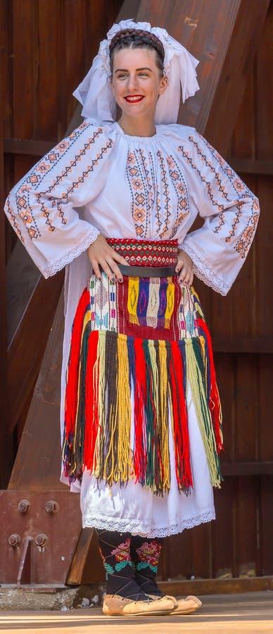 Serbian woman dancer in traditional costume. ROMANIA, TIMISOARA - JULY 7, 2019: Young Serbian woman dancer in traditional costume, present at the international stock image