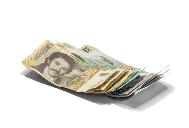 Serbisk pengarbunt av sedlar av olikt värde i serbiska dinar som isoleras på en vit bakgrund fotografering för bildbyråer