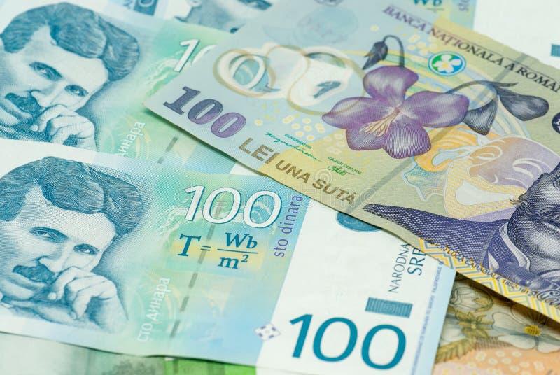 Serbiska dinar och handeln för kommers för romanian leisedelspridning den bilaterala utbyter begrepp royaltyfri bild