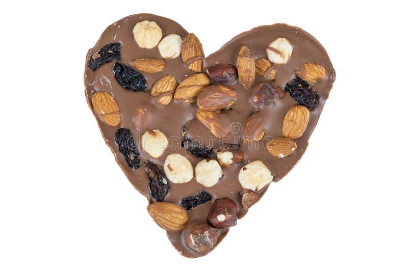 Serce kształtował czekoladę z dokrętkami na białym tle fotografia stock
