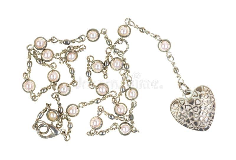 Serce kształtujący medalion na srebnym łańcuchu fotografia royalty free