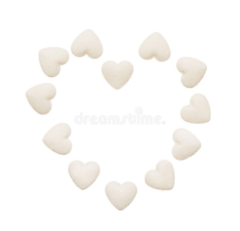 Serce robić białe kierowe kształt pastylki odizolowywać na bielu obrazy royalty free