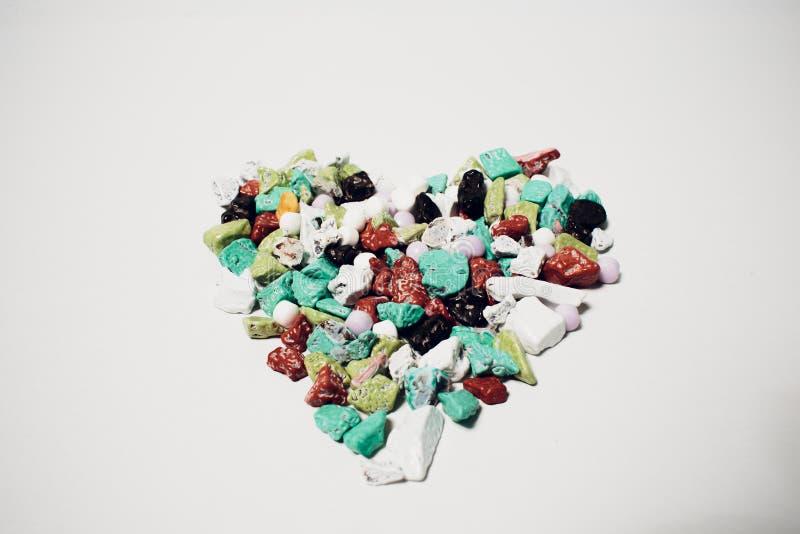 Sercowate adra dla walentynka dnia tła pracy arabscy cukierki cukierek formą kolorowi kamienie w kształcie obrazy royalty free