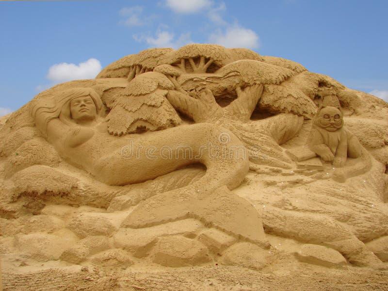 A sereia maded na areia imagens de stock