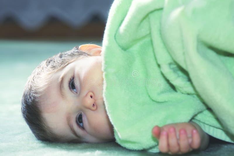 Download Serene baby on green floor stock photo. Image of towel - 14903882
