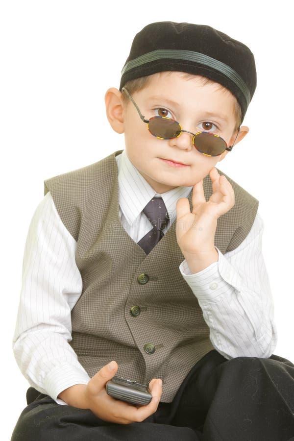 Serene boy in black cap