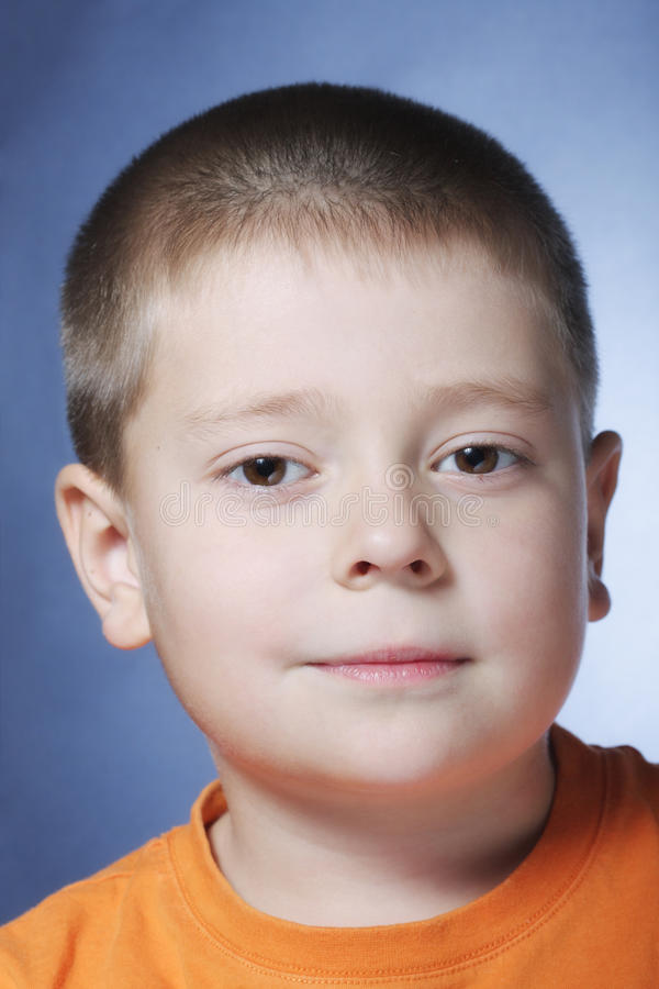 Download Serene boy in orange stock photo. Image of portrait, person - 13521186