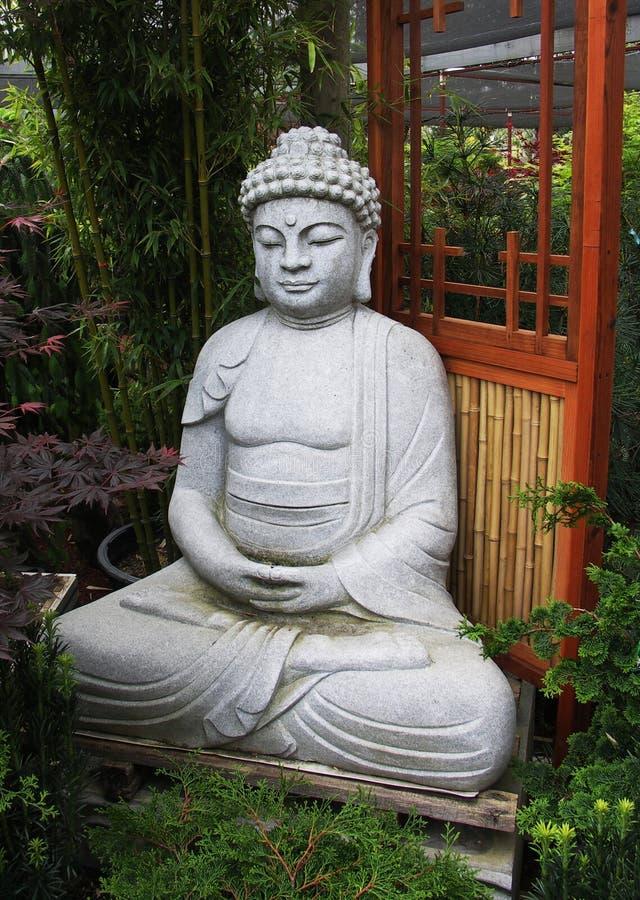 Serene Buddha in Bamboo Garden. Serene Buddha sculpture in Bamboo Garden stock image