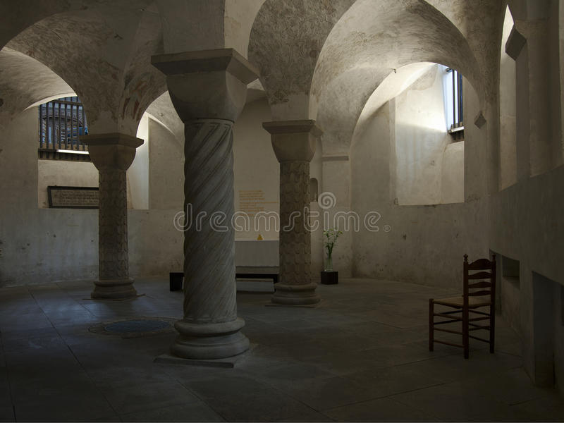 Serene candlelight in ancient crypt. Ancient crypt under Romaneque church stock photos
