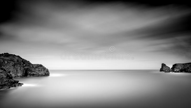Serene Coastline, Bossiney Bay, North Cornwall. Serene and tranquil coastline, captured in black and white, Bossiney Bay, North Cornwall, UK stock photo
