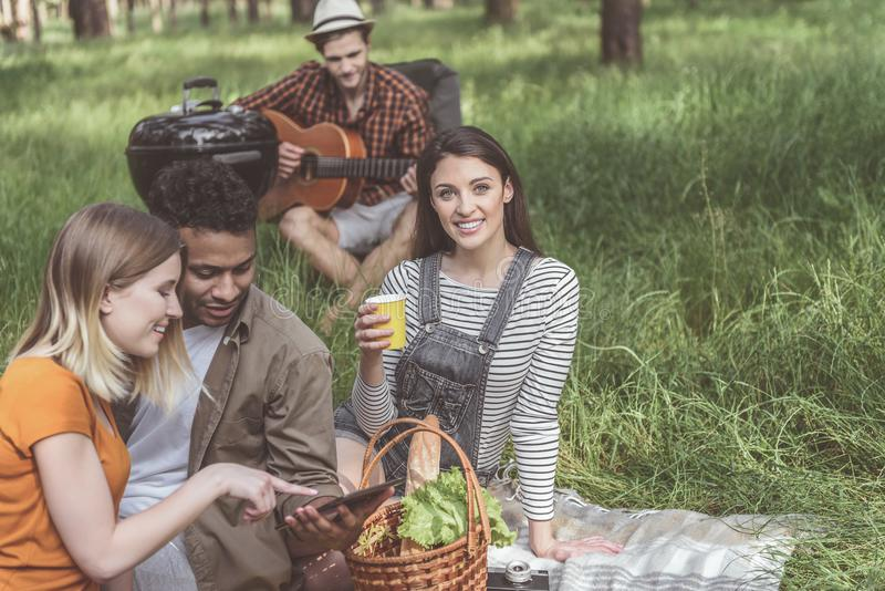 Carefree friends having good time at a picnic royalty free stock image