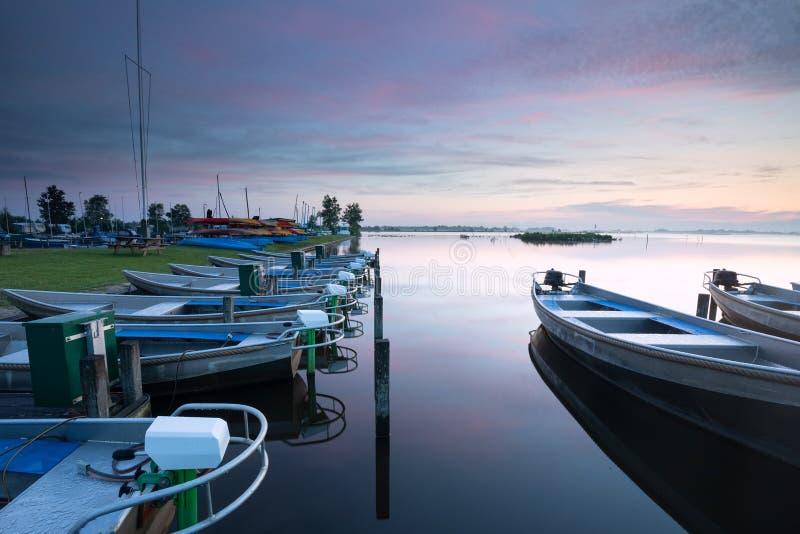 Serene dusk over harbor on big lake royalty free stock photography