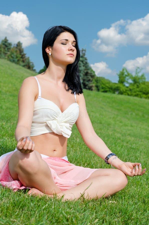 Serene Girl Meditating On Grass Stock Photography