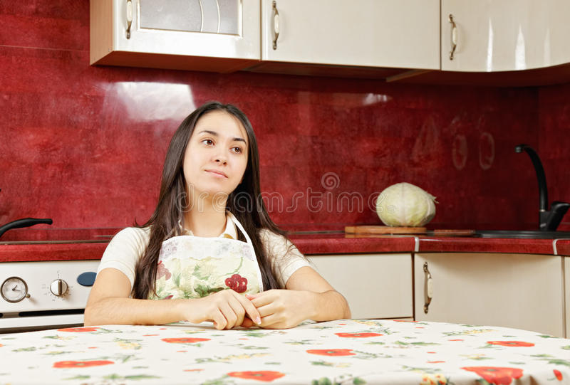 Serene Housewife In Kitchen Stock Image