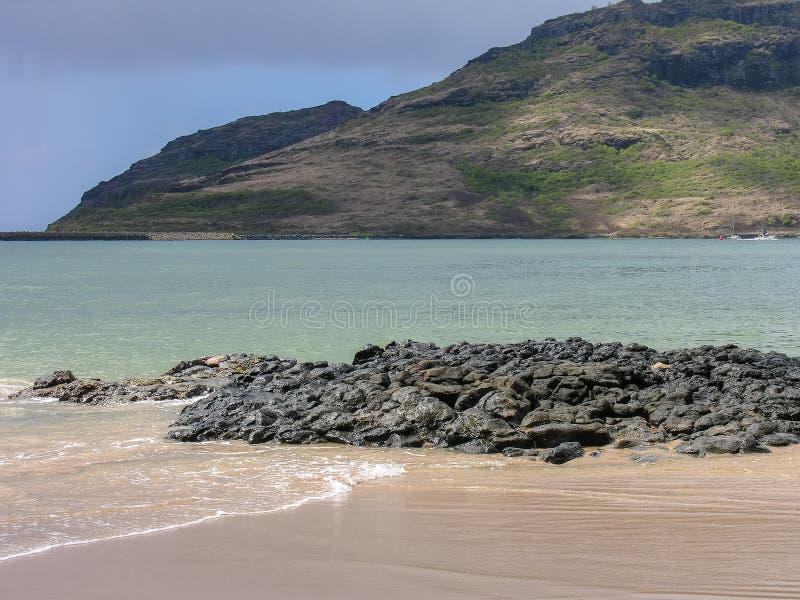 Serene image of water and mountain in Kauai, Hawaii royalty free stock photography