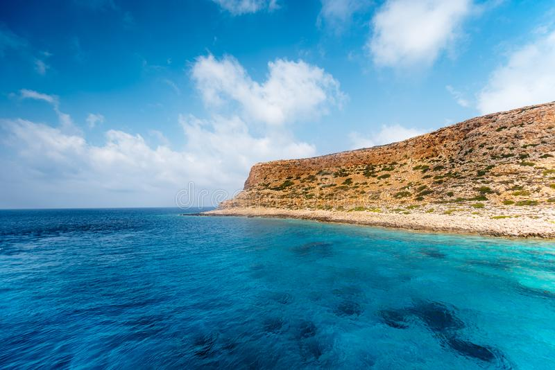 Serene landscape with clear sea water and island in sight royalty free stock images