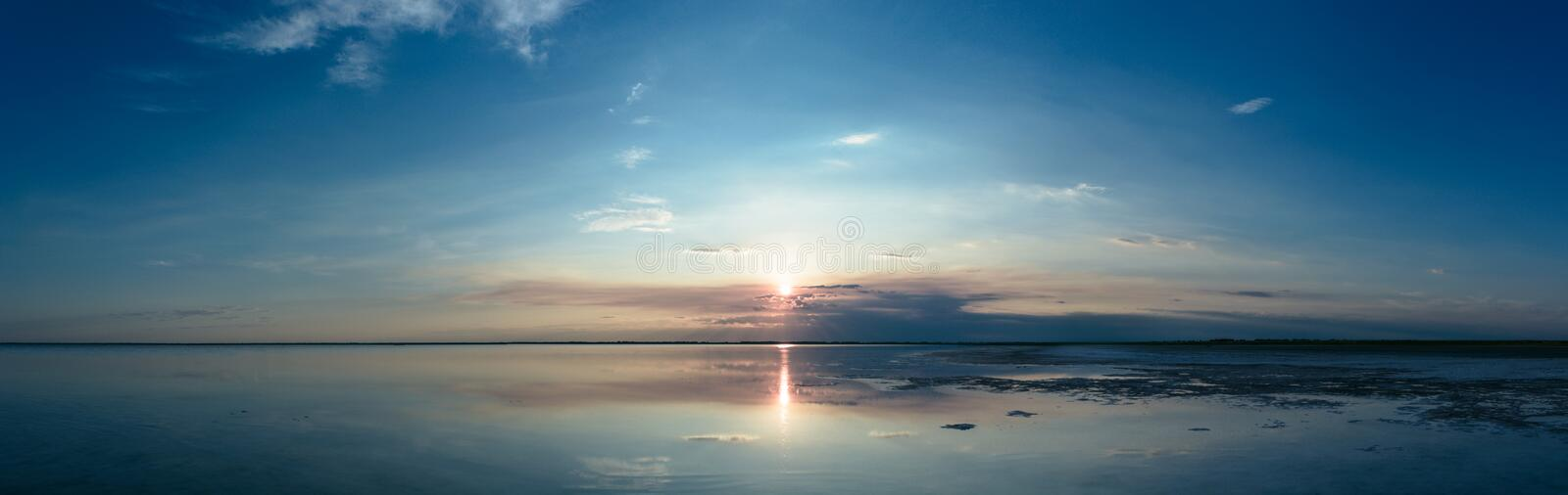 The serene landscape of the lake and the sky reflected in the water stock images