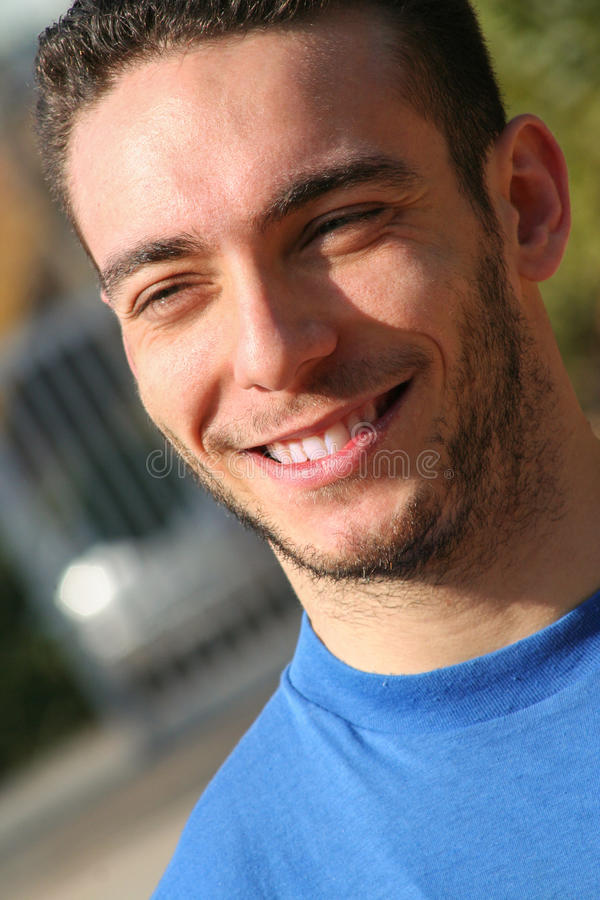 Serene man smiling, joyful and peaceful. Trust boy stock image
