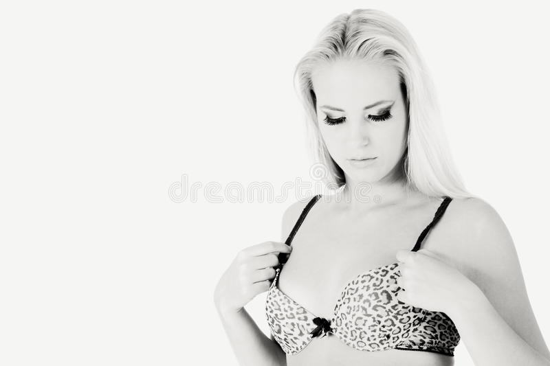Download Serene Model Checking Her Bra In Black And White Stock Photo - Image: 10506410