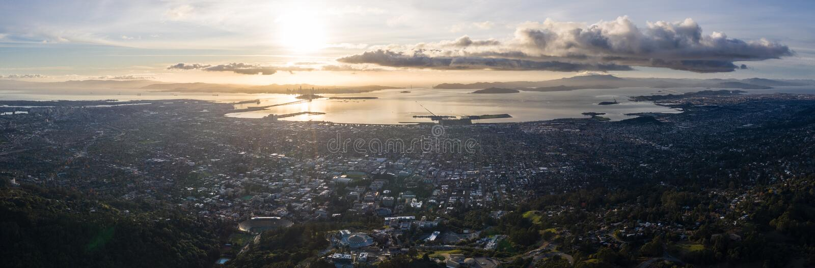 Aerial View of San Francisco Bay Area at Dusk. A serene sunset illuminates the densely populated San Francisco Bay area including Oakland, Berkeley, Emeryville royalty free stock photos