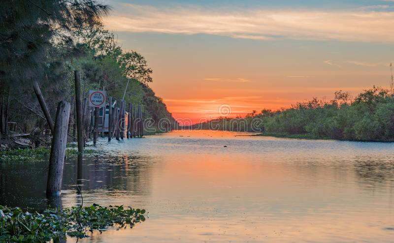 Serene Sunset on the St Johns River. A small canal leads to the St Johns River in Brevard County Florida and is where airboats launch stock photography