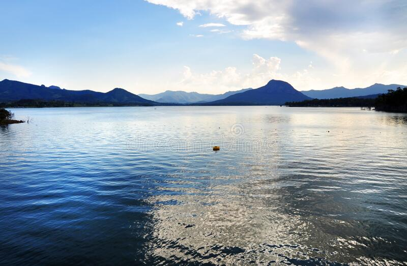 Serene tranquil deep blue sparkling water lake mountain ranges stock photography