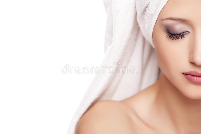 Serene woman with a towel stock images