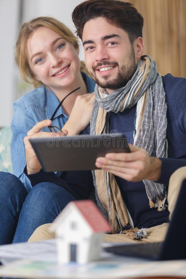 Serene young couple looking at tablet together royalty free stock photography