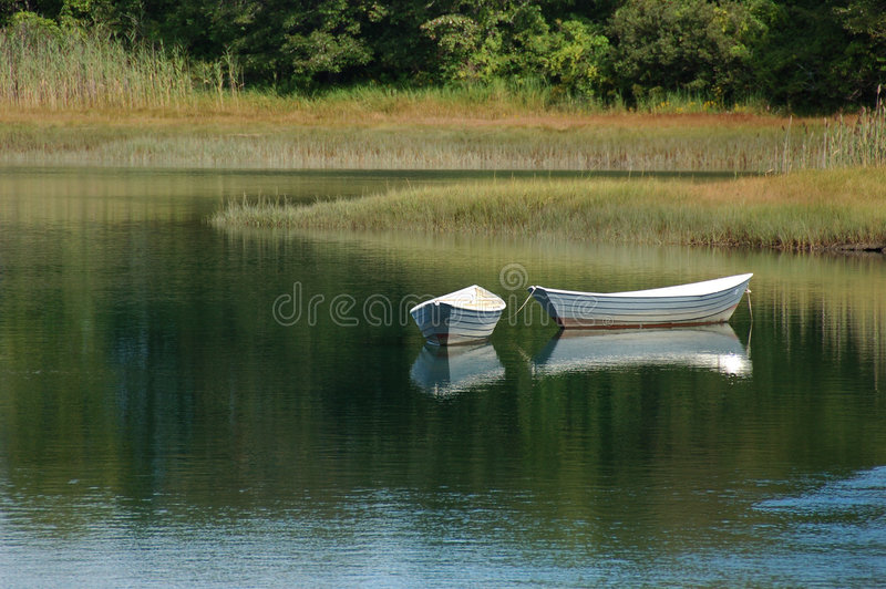 Serenity. Boats floating on a lake stock photos